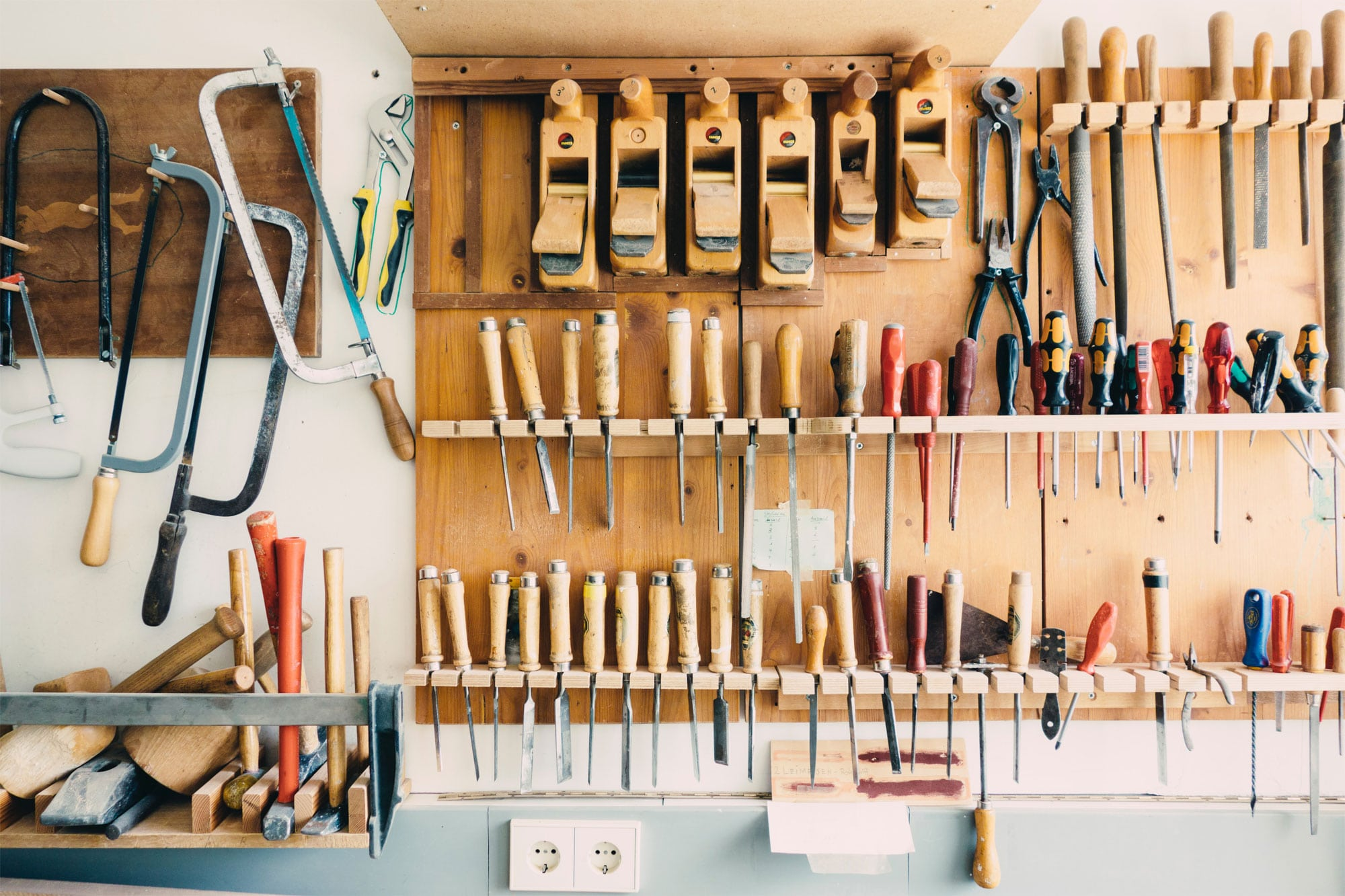 A wall of garage tools to symbolism the many web design tools to choose from